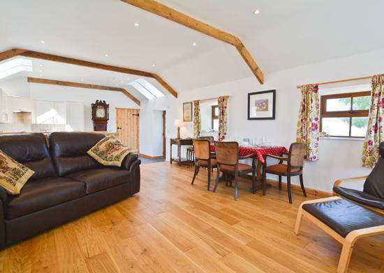 Comfortable lounge and dining area at  Curlew Cottage, self catering holiday accommodation, Lilswood Farm, Hexham, Northumberland  uk
