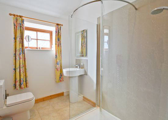 The double bedded room has en suite shower, w.c., and handbasin.  Curlew Cottage  self catering holiday accommodation North Pennines near Hexham and Hadrian's Wall Northumberland North East England uk